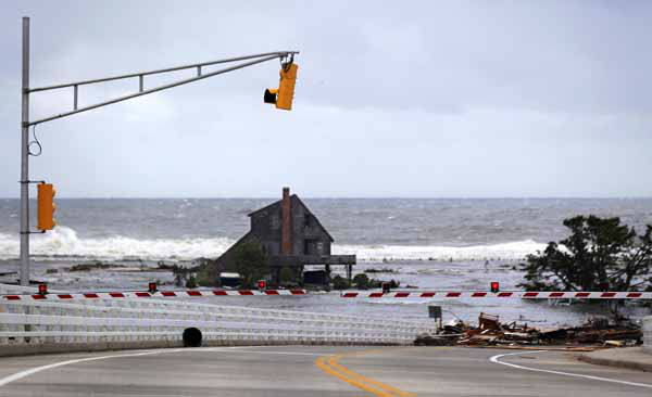 A lone home sits on the beach in an area that residents say was filled with homes but are now gone the morning after superstorm Sandy rolled through, Tuesday, Oct. 30, 2012, in Mantoloking, N.J. Debris from Betty Wagner&#39;s home, lower right, rests on top of the Mantoloking Bridge. Sandy, the storm that made landfall Monday, caused multiple fatalities, halted mass transit and cut power to more than 6 million homes and businesses. &#40;AP Photo&#47;Julio Cortez&#41; <span class=meta>(AP Photo&#47; Julio Cortez)</span>