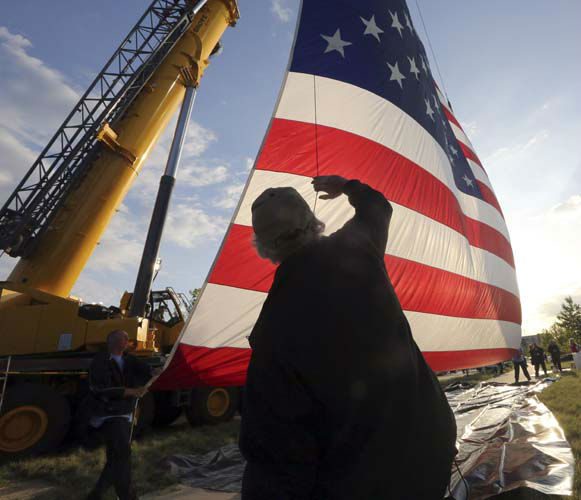 Dennis Courtney helps hang large U.S. Flag before the dedication of the George W. Bush Presidential Center, Thursday, April 25, 2013, in Dallas. &#40;AP Photo&#47;Kim Johnson&#41; <span class=meta>(AP Photo&#47; Kim Johnson)</span>