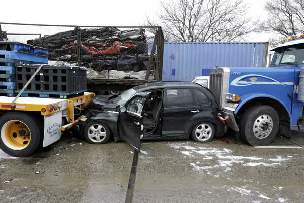 "<div class=""meta ""><span class=""caption-text "">Snow squalls and slippery roads led to a series of accidents that left at least three people dead and 20 injured on a mile-long stretch of southbound I-75 in Detroit. More than two dozen vehicles, including tractor-trailers, were involved in the pileups. (AP Photo/Paul Sancya)</span></div>"