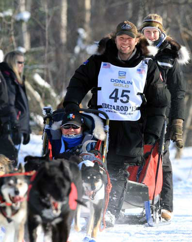 Curt Perano of New Zealand drives his team during the ceremonial start of the Iditarod Trail Sled Dog Race Saturday, March 2, 2013, in Anchorage, Alaska. The competitive portion of the 1,000-mile race is scheduled to begin Sunday in Willow, Alaska. &#40;AP Photo&#47;Dan Joling&#41; <span class=meta>(AP Photo&#47; Dan Joling)</span>