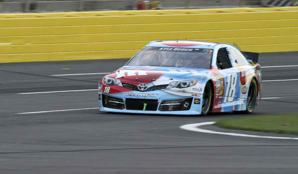 "<div class=""meta ""><span class=""caption-text "">In this photo provided by Fernando Echeverria, Kyle Busch drives over a broken television camera cable during the NASCAR Sprint Cup series Coca-Cola 600 auto race at Charlotte Motor Speedway in Concord, N.C., Sunday, May 26, 2013. (AP Photo/Fernando Echeverria) (AP Photo/ Fernando Echeverria)</span></div>"