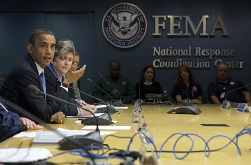 President Barack Obama, accompanied by Homeland Security Secretary Janet Napolitano, second from left, and others, speaks about superstorm Sandy during a visit to the Federal Emergency Management Agency &#40;FEMA&#41; Headquarters in Washington, Wednesday, Oct. 31, 2012.  <span class=meta>(AP Photo&#47; Carolyn Kaster)</span>