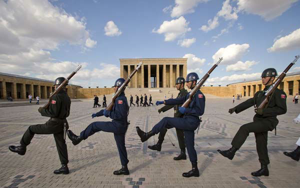 "<div class=""meta image-caption""><div class=""origin-logo origin-image ""><span></span></div><span class=""caption-text"">Turkish soldiers march during a changing of the guards ceremony at the mausoleum of Mustafa Kemal Ataturk, the founder of modern Turkey, in Ankara, Turkey, Monday, June 10, 2013. In a series of increasingly belligerent speeches to cheering supporters Sunday, Erdogan launched a verbal attack on the tens of thousands of anti-government protesters who flooded the streets for a 10th day, accusing them of creating an environment of terror. (AP Photo/Vadim Ghirda) (AP Photo/ Vadim Ghirda)</span></div>"