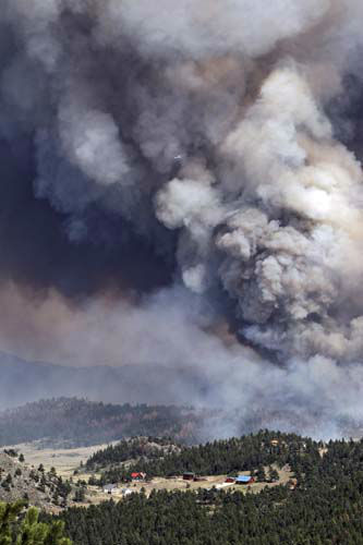 "<div class=""meta ""><span class=""caption-text "">FILE - In this June 22, 2012 file photo, the High Park wildfire burns behind homes north of Poudre Canyon in the Glacier View area near Livermore, Colo. The federal government on Monday belatedly sent $67 million in disaster relief to 15 states, with the biggest share, $19 million, going to Colorado to help recovery from last year's devastating wildfires. (AP Photo/Ed Andrieski, File) (AP Photo/ Ed Andrieski)</span></div>"