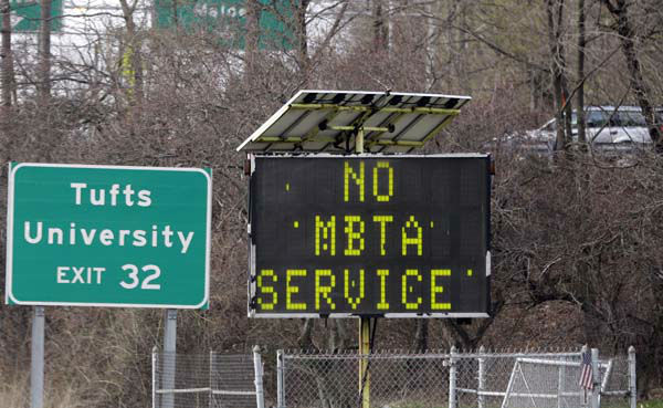 A sign along I-93 in Medford, Mass. announces no MBTA service Friday, April 18, 2013. Two suspects in the Boston Marathon bombing killed an MIT police officer, injured a transit officer in a firefight and threw explosive devices at police during their getaway attempt in a long night of violence that left one of them dead and another still at large Friday, authorities said as the manhunt intensified for a young man described as a dangerous terrorist. &#40;AP Photo&#47;Elise Amendola&#41; <span class=meta>(AP Photo&#47; Elise Amendola)</span>