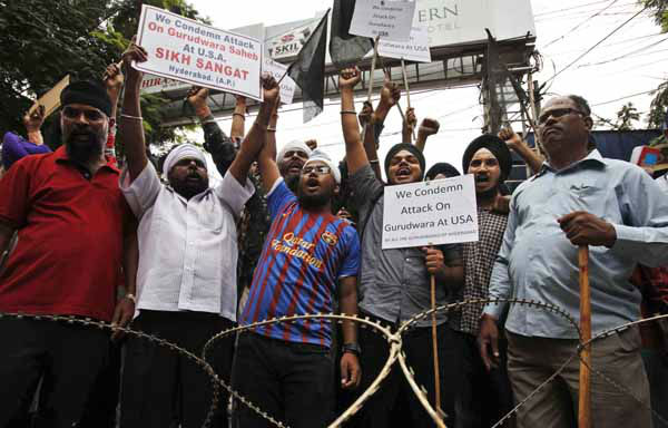 Indian Sikhs shout slogans in front of the U.S. Consulate during a protest in Hyderabad, India, Monday, Aug. 6, 2012 to condemn Sunday&#39;s shooting at a Sikh temple in the U.S. state of Wisconsin. Indian Prime Minister Manmohan Singh said Monday that he was shocked and saddened by the shooting attack that killed six people. &#40;AP Photo&#47;Mahesh Kumar A.&#41; <span class=meta>(AP Photo&#47; Mahesh Kumar A)</span>