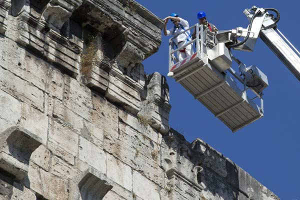 "<div class=""meta ""><span class=""caption-text "">Technicians drop a stone from the top of Rome's ancient Colosseum to evaluate possible risks to visitors, Wednesday, July 18, 2012.  Colosseum director Rossella Rea said the test are being done to evaluate the eventual need of new safety measures in case of an accidental fall of rocks from the monument. She also said that the recent climate changes, with unusually heavy rains, snowfalls and extreme temperatures are causing micro deterioration that could ease the release of stone fragments. (AP Photo/Andrew Medichini) (AP Photo/ Andrew Medichini)</span></div>"