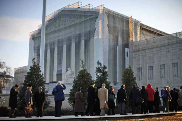People line up for entrance into the Supreme Court in Washington, Tuesday, March 26, 2013, where the court will hear arguments on California?s voter approved ban on same-sex marriage, Proposition 8. &#40;AP Photo&#47;Pablo Martinez Monsivais&#41; <span class=meta>(AP Photo&#47; Pablo Martinez Monsivais)</span>