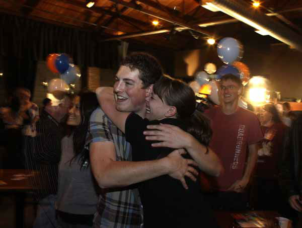 People attending an Amendment 64 watch party in a bar hug after a local television station announced the marijuana amendment&#39;s passage, in Denver, Colo., Tuesday, Nov. 6, 2012. The amendment would make it legal in Colorado for individuals to possess and for businesses to sell marijuana for recreational use. &#40;AP Photo&#47;Brennan Linsley&#41; <span class=meta>(AP Photo&#47; Brennan Linsley)</span>