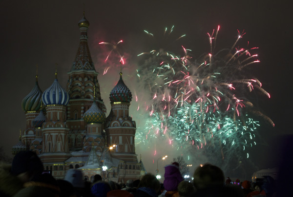 "<div class=""meta ""><span class=""caption-text "">Fireworks explode in the sky over St. Basil Cathedral as Russians celebrate New Year on Red Square in Moscow, Russia, on Tuesday, Jan. 1, 2013. (AP Photo/Ivan Sekretarev)</span></div>"