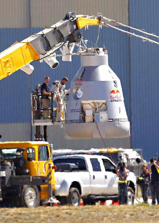 "<div class=""meta ""><span class=""caption-text "">Felix Baumgartner disembarks from the balloon capsule after his mission was aborted in Roswell, N.M. on Tuesday, Oct. 9, 2012. Baumgartner was attempting to break the speed of sound with his own body by jumping from a space capsule lifted by a 30 million cubic foot helium balloon. (AP Photo/Matt York) (AP Photo/ Matt York)</span></div>"