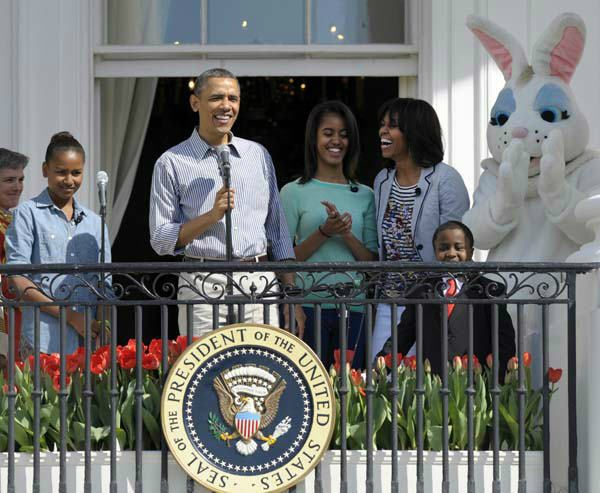 President Barack Obama, accompanied by first lady Michelle Obama, daughters Sasha and Malia, The Easter Bunny and Robby Novak, better known as Kid President, speaks to the crowd on the South Lawn from the Truman Balcony of the White House in Washington, Monday, April 1, 2013, during the annual Easter Egg Roll. &#40;AP Photo&#47;Susan Walsh&#41; <span class=meta>(AP Photo&#47; Susan Walsh)</span>