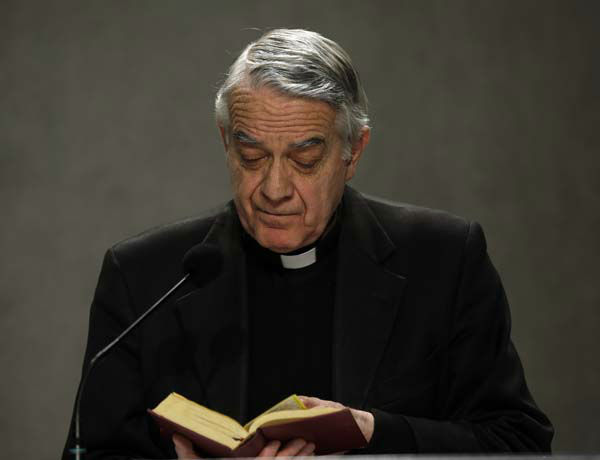 "<div class=""meta ""><span class=""caption-text "">Vatican spokesman Father Federico Lombardi reads from ""Code of the Canon Law"" as he meets journalists at the Vatican, Monday, Feb. 11, 2013. Pope Benedict XVI announced Monday that he would resign Feb. 28 ? the first pontiff to do so in nearly 600 years. The decision sets the stage for a conclave to elect a new pope before the end of March. (AP Photo/Gregorio Borgia) (AP Photo/ Gregorio Borgia)</span></div>"