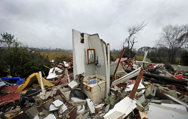 "<div class=""meta ""><span class=""caption-text "">The remnants of a bathroom stand amidst the wreckage of a destroyed home after a tornado struck, Wednesday, Jan. 30, 2013, in Adairsville, Ga. A fierce storm system that roared across Georgia has left at least one person dead after it demolished buildings and flipped vehicles on Interstate 75 northwest of Atlanta. (AP Photo/David Goldman) (AP Photo/ David Goldman)</span></div>"