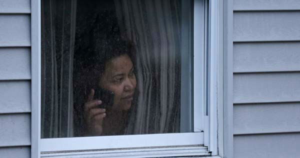 "<div class=""meta ""><span class=""caption-text "">A woman looks out a window at her home as police start to search an apartment building while looking for a suspect in the Boston Marathon bombings in Watertown, Mass., Friday, April 19, 2013. Two suspects in the Boston Marathon bombing killed an MIT police officer, injured a transit officer in a firefight and threw explosive devices at police during their getaway attempt in a long night of violence that left one of them dead and another still at large Friday, authorities said as the manhunt intensified for a young man described as a dangerous terrorist. (AP Photo/Charles Krupa) (AP Photo/ Charles Krupa)</span></div>"