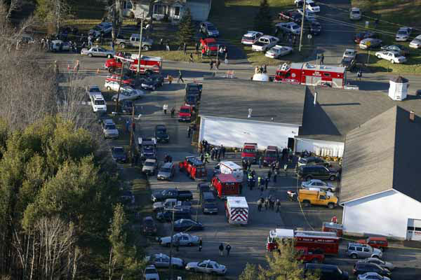 This aerial photo shows a triage area set up at the Sandy Hook fire station in Newtown, Conn., near where authorities say a gunman opened fire inside Sandy Hook Elementary School in a shooting that left 27 people dead, including 20 children, Friday, Dec. 14, 2012. &#40;AP Photo&#47;Julio Cortez&#41; <span class=meta>(AP Photo&#47; Julio Cortez)</span>