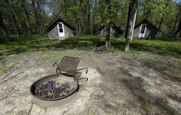 This Tuesday, May 14, 2013 photo shows a fire pit and cabins at the Camp Conestoga Girls Scouts camp, in New Liberty, Iowa. In an effort to save money, Girl Scout councils across the country are making proposals that would have been unthinkable a generation ago: selling summer camps that date back to the 1950s. &#40;AP Photo&#47;Charlie Neibergall&#41; <span class=meta>(AP Photo&#47; Charlie Neibergall)</span>