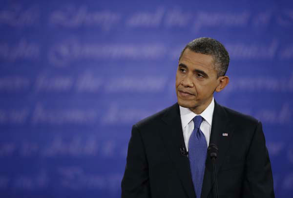 President Barack Obama listens to Republican presidential nominee Mitt Romney during the first presidential debate at the University of Denver, Wednesday, Oct. 3, 2012, in Denver. &#40;AP Photo&#47;David Goldman&#41; <span class=meta>(AP Photo&#47; David Goldman)</span>