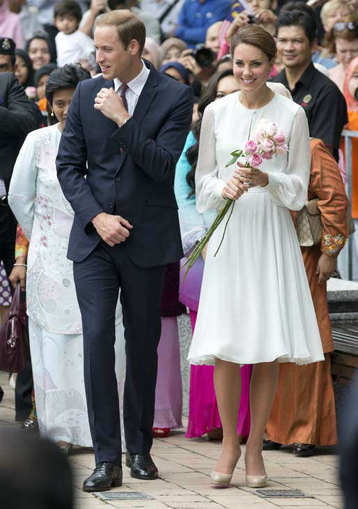 Prince William and his wife Kate, the Duke and Duchess of Cambridge take a walk through a central city park in Kuala Lumpur, Malaysia, Friday, Sept. 14, 2012. Prince William and Kate are on a nine-day tour of the Far East and South Pacific in celebration of Queen Elizabeth II&#39;s Diamond Jubilee. &#40;AP Photo&#47;Mark Baker&#41; <span class=meta>(AP Photo&#47; Mark Baker)</span>