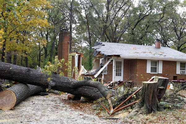 A firefighter leaves a destroyed home in Pasadena, Md., Tuesday, Oct. 30, 2012, where the homeowner was killed overnight when a tree fell on his home during superstorm Sandy. Neighbor John Brown identified the victim as Donald Cannata Sr. &#40;AP Photo&#47;Jose Luis Magana&#41; <span class=meta>(AP Photo&#47; Jose Luis Magana)</span>