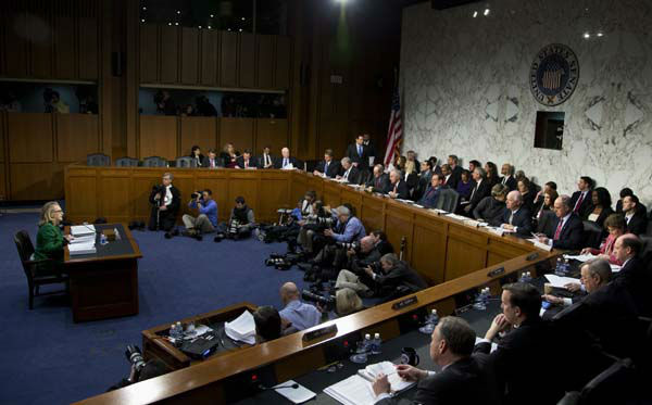 "<div class=""meta ""><span class=""caption-text "">Secretary of State Hillary Rodham Clinton, left, testifies on Capitol Hill in Washington, Wednesday, Jan. 23, 2013, before the Senate Foreign Relations Committee hearing on the deadly September attack on the U.S. diplomatic mission in Benghazi, Libya, that killed Ambassador Chris Stevens and three other Americans.   (AP Photo/Manuel Balce Ceneta) (AP Photo/ Manuel Balce Ceneta)</span></div>"