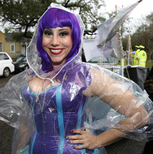 Rachel Kohn poses for a photo in her clear raincoat she prepares to march in the Orpheus Mardi Gras parade in New Orleans,  Monday, Feb. 11, 2013.  Rain greeted the start of the parade. &#40;AP Photo&#47;Bill Haber&#41; <span class=meta>(AP Photo&#47; Bill Haber)</span>