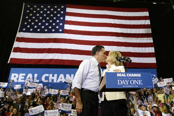 "<div class=""meta ""><span class=""caption-text "">Republican presidential candidate, former Massachusetts Gov. Mitt Romney kisses his wife Ann as they take the stage at a Virginia campaign rally, Monday, Nov. 5, 2012, at The Patriot Center, George Mason University in Fairfax, Va. (AP Photo/Charles Dharapak)</span></div>"