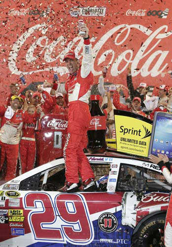 "<div class=""meta ""><span class=""caption-text "">Kevin Harvick celebrates in victory lane after winning the NASCAR Sprint Cup series Coca-Cola 600 auto race at Charlotte Motor Speedway in Concord, N.C., Sunday, May 26, 2013. (AP Photo/Chuck Burton) (AP Photo/ Chuck Burton)</span></div>"