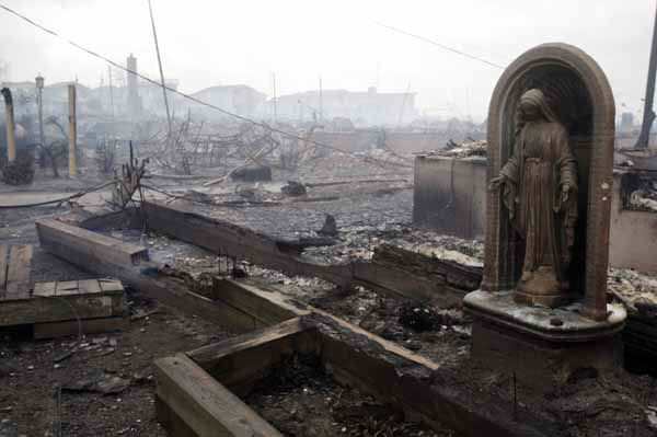 "<div class=""meta ""><span class=""caption-text "">Damage caused by a fire at Breezy Point is shown Tuesday, Oct. 30, 2012, in New York. A fire department spokesman says more than 190 firefighters are at the blaze in the Breezy Point section. Fire officials say the blaze was reported around 11 p.m. Monday in an area flooded by the superstorm that began sweeping through earlier. (AP Photo/Frank Franklin II) (AP Photo/ Frank Franklin II)</span></div>"