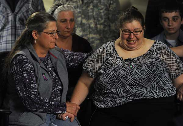 As Jessica&#39;s mother, Sarah Ridgeway begins to cry, she is comforted by her aunt, Gay Moore, left, and by Sarah&#39;s great aunt Wendy Pesavento at the Westminster Police Department in Westminster, Colo., on Tuesday, Oct. 9, 2012. The family of Jessica Ridgeway gathered to talk about Jessica and ask for her safe return. Jessica went missing Friday while on her way to school.  <span class=meta>(AP Photo&#47;The Denver Post, Kathryn Scott Osler, Pool)</span>