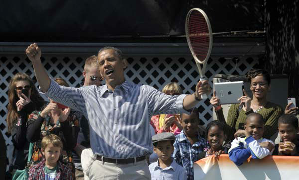 President Barack Obama reacts while playing tennis during the annual Easter Egg Roll on the South Lawn of the White House in Washington, Monday, April 1, 2013. &#40;AP Photo&#47;Susan Walsh&#41; <span class=meta>(AP Photo&#47; Susan Walsh)</span>
