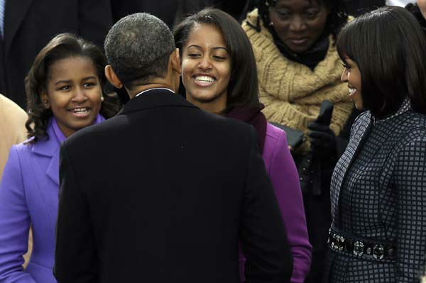President Barack Obama greets his daughter Sasha and Malia as first lady Michelle Obama watches at the ceremonial swearing-in at the U.S. Capitol during the 57th Presidential Inauguration in Washington, Monday, Jan. 21, 2013. &#40;AP Photo&#47;Evan Vucci&#41; <span class=meta>(AP Photo&#47; Evan Vucci)</span>