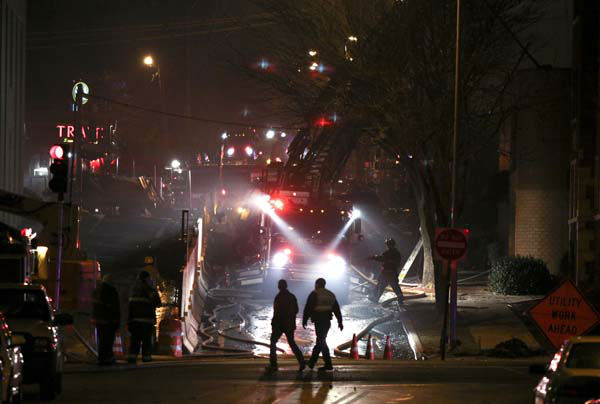 Firemen and utility workers respond to a gas explosion and massive fire Tuesday night, Feb. 19, 2013 in the Plaza shopping district in Kansas City, Mo. A car crashed into a gas main in the upscale shopping district, sparking a massive blaze that engulfed an entire block and caused multiple injuries, police said  &#40;AP Photo&#47;Ed Zurga&#41; <span class=meta>(AP Photo&#47; Ed Zurga)</span>