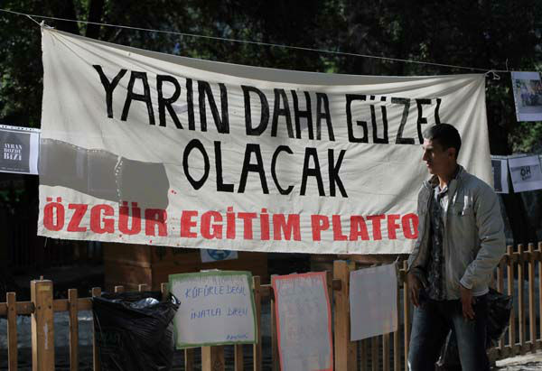 "<div class=""meta image-caption""><div class=""origin-logo origin-image ""><span></span></div><span class=""caption-text"">A man walks past a banner that reads "" tomorrow will be better "" in Kugulu Park, early morning in Ankara, Turkey, Tuesday, June 11, 2013. Hundreds of police in riot gear forced through barricades in Taksim Square early Tuesday, pushing many of the protesters who had occupied the square for more than a week into a nearby park in Istanbul. Turkey's Prime Minister Recep Tayyip Erdogan made it more than clear that he had come to the end of his tolerance. (AP Photo/Burhan Ozbilici) (AP Photo/ Burhan Ozbilici)</span></div>"