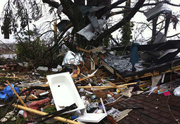 "<div class=""meta ""><span class=""caption-text "">Debris lies on yard after a tornado moved through  Adairsville, Ga. Wednesday, Jan. 30, 2013. A fierce storm system that roared across northwest Georgia has left at least one person dead and a trail of damage that included demolished buildings in downtown Adairsville and vehicles overturned on Interstate 75 northwest of Atlanta.  A tornado touched down in Adairsville, and authorities confirmed that at least one person was killed in the town about 60 miles northwest of Atlanta. (AP Photo/David Goldman) (AP Photo/ David Goldman)</span></div>"