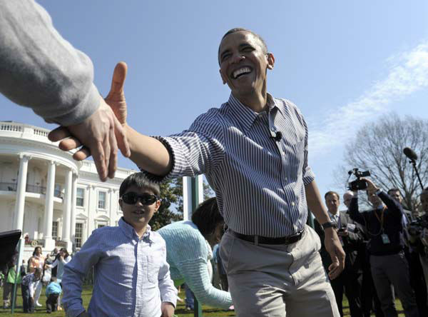 President Barack Obama shakes hands during the annual Easter Egg Roll on the South Lawn of the White House in Washington, Monday, April 1, 2013. &#40;AP Photo&#47;Susan Walsh&#41; <span class=meta>(AP Photo&#47; Susan Walsh)</span>