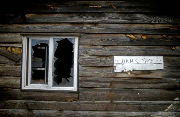 A sign hangs next to a damaged window outside a barbecue restaurant after a tornado struck, Wednesday, Jan. 30, 2013, in Adairsville, Ga. A fierce storm system that roared across Georgia has left at least one person dead after it demolished buildings and flipped vehicles on Interstate 75 northwest of Atlanta. &#40;AP Photo&#47;David Goldman&#41; <span class=meta>(AP Photo&#47; David Goldman)</span>