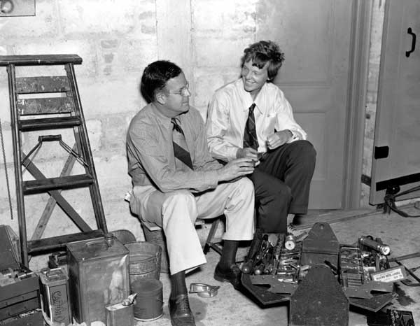 "<div class=""meta image-caption""><div class=""origin-logo origin-image ""><span></span></div><span class=""caption-text"">American aviatrix Amelia Earhart, right, and her husband, publisher George Putnam, talk over plans for Earhart's second attempt to fly around the world. They are in a hangar where Earhart's plane Electra is being prepared for flight in Miami, Fla., May 29, 1937.  ((AP Photo))</span></div>"