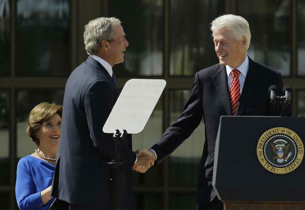 Former president George W. Bush, left, shakes hands with former president William J. Clinton during the dedication of the George W. Bush Presidential Center Thursday, April 25, 2013, in Dallas. &#40;AP Photo&#47;David J. Phillip&#41; <span class=meta>(AP Photo&#47; David J. Phillip)</span>