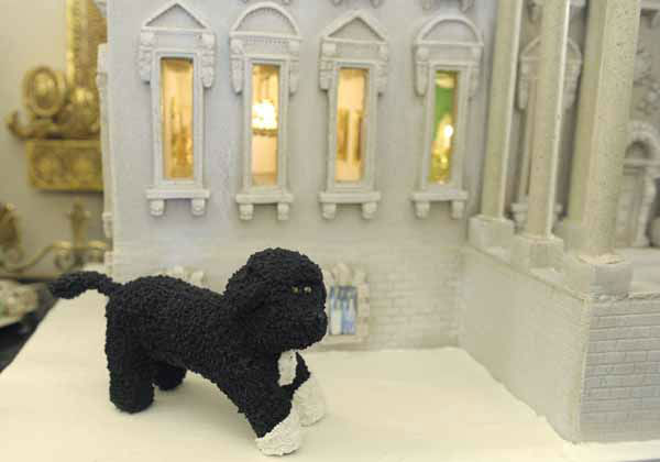 "<div class=""meta ""><span class=""caption-text "">Bo, the Obama family pet, is replicated on the nearly 300-pound gingerbread house of the White House on display in the State Dining Room of the White House in Washington, Wednesday, Nov. 28, 2012. The theme for the White House Christmas 2012 is Joy to All. The White House gingerbread house has been a tradition since the 1960s. (AP Photo/Susan Walsh) (AP Photo/ Susan Walsh)</span></div>"