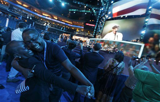 "<div class=""meta ""><span class=""caption-text "">North Carolina delegates Denise Adams, left, and Charles Evans dance on the floor as musician James Taylor sings, ""How Sweet It Is To Be Loved By You,"" during a sound check at the Democratic National Convention in Charlotte, N.C., on Thursday, Sept. 6, 2012. (AP Photo/David Goldman) (AP Photo/ David Goldman)</span></div>"