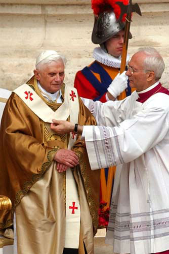 FILE - In this Sunday, April 24, 2005 file photo, Archbishop Piero Marini drapes Pope Benedict XVI with the pallium during his installment Mass in St. Peter&#39;s Square at the Vatican. Pope Benedict XVI announced Monday, Feb. 11, 2013, he would resign Feb. 28 because he is simply too old to carry on. &#40;AP Photo&#47;Gregorio Borgia, File&#41; <span class=meta>(AP Photo&#47; Gregorio Borgia)</span>