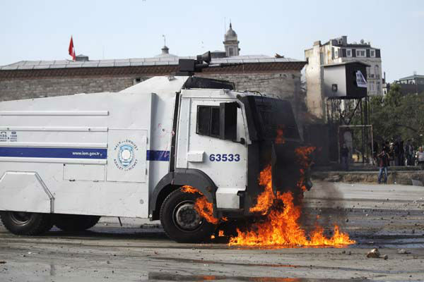 A petrol bomb petrol bomb explodes on a police water cannon truck during clashes in Taksim Square in Istanbul, Turkey, Tuesday, June 11, 2013. Hundreds of police in riot gear forced through barricades in Istanbul&#39;s central Taksim Square early Tuesday, pushing many of the protesters who had occupied the square for more than a week into a nearby park. &#40;AP Photo&#47;Kostas Tsironis&#41; <span class=meta>(AP Photo&#47; Kostas Tsironis)</span>
