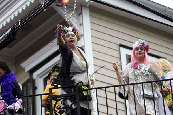 Revelers throw beads from a balcony as the Society of Saint Anne walking parade marches by in the Bywater section of New Orleans during Mardi Gras day, Tuesday, Feb. 12, 2013. &#40;AP Photo&#47;Gerald Herbert&#41; <span class=meta>(AP Photo&#47; Gerald Herbert)</span>