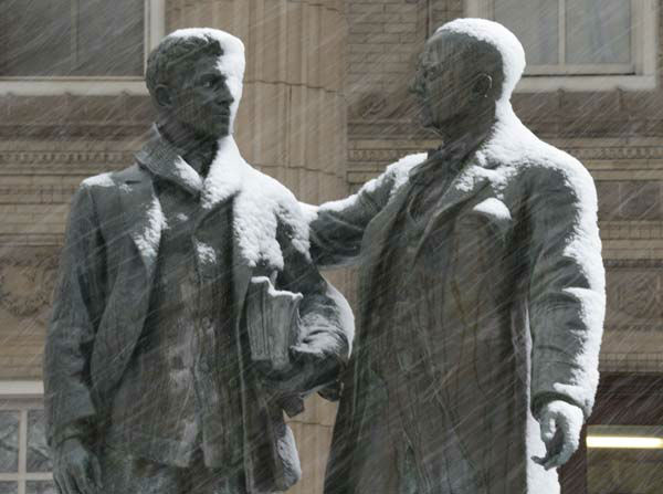 Snow begins to gathers on a statue on the University of Kansas campus in Lawrence, Kan., Saturday, March 23, 2013. The area is under a winter storm warning. &#40;AP Photo&#47;Orlin Wagner&#41; <span class=meta>(AP Photo&#47; Orlin Wagner)</span>