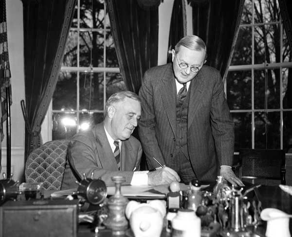 In this April 2, 1940 file photo, William L. Austin, director of the U.S. Census Bureau, right, helps President Franklin D. Roosevelt fill out the large form at the White House in Washington. Veiled in secrecy for 72 years because of privacy protections, the 1940 U.S. Census is the first historical federal decennial survey to be made available on the Internet initially rather than on microfilm. &#40;AP Photo&#41; <span class=meta>(AP Photo)</span>