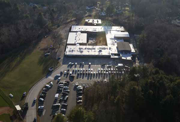 This aerial photo shows Sandy Hook Elementary School in Newtown, Conn. where authorities say a gunman opened fire in a shooting that left 27 people dead, including 20 children, Friday, Dec. 14, 2012. &#40;AP Photo&#47;Julio Cortez&#41; <span class=meta>(AP Photo&#47; Julio Cortez)</span>
