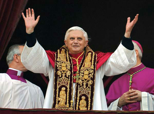 FILE - This April 19, 2005 file photo shows Pope Benedict XVI greeting the crowd from the central balcony of St. Peter&#39;s Basilica moments after being elected, at the Vatican. On Monday, Feb. 11, 2013 Benedict XVI announced he would resign Feb. 28, the first pontiff to do so in nearly 600 years. The decision sets the stage for a conclave to elect a new pope before the end of March. &#40;AP Photo&#47;Domenico Stinellis&#47;FILE&#41; <span class=meta>(AP Photo&#47; Domenico Stinellis)</span>