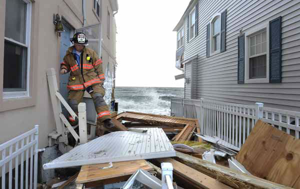 Milford Fire Department Capt. Christopher Waiksnoris checks for residents during another evacuation due to high tide in Milford, Conn., Tuesday, Oct. 30, 2012. Superstorm Sandy made landfall Monday, and caused multiple fatalities, halted mass transit and cut power to more than 6 million homes and businesses. &#40;AP Photo&#47;Jessica Hill&#41; <span class=meta>(AP Photo&#47; Jessica Hill)</span>