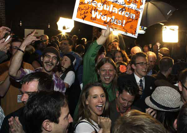 "<div class=""meta image-caption""><div class=""origin-logo origin-image ""><span></span></div><span class=""caption-text"">People attending an Amendment 64 watch party in a bar celebrate after a local television station announced the marijuana amendment's passage, in Denver, Colo., Tuesday, Nov. 6, 2012. The amendment would make it legal in Colorado for individuals to possess and for businesses to sell marijuana for recreational use. (AP Photo/Brennan Linsley) (AP Photo/ Brennan Linsley)</span></div>"